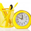 The modern hours an alarm clock, ballpoint pen, scissors and a cutter in the stand — Stock Photo
