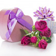 Two gift boxes with a bow and ribbon, bouquet of the beautiful roses, isolated on white — Stock Photo #32295239