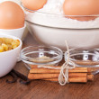 Stock Photo: Flour and eggs, raisin, sesame, vanilla and cinnamon on a table