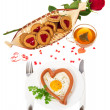 Festive a breakfast on Valentine's Day, sausage in the form of heart, fried egg, hot tea, red rose, cookies isolated on white — Stock Photo