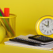 Exercise book, the calculator, a handles in a support an alarm clock and apple — Stock Photo