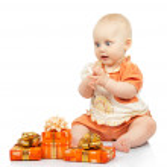 Joyful baby with gifts isolated on white — Stock Photo #32296217