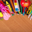 Set of bright office tools, a paints and apple on a table — Stock Photo #32296743