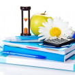 The books, notepad, stationery, calculator, hourglass, apple and chamomile — Stock Photo
