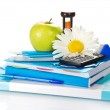 The books, notepad, stationery, calculator, hourglass, apple and chamomile — Stock Photo #32296907