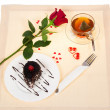 Chocolate cake, hot tea and red rose on a cloth decorated with hearts in Valentine's day — Stock Photo #32297007