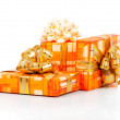 Colorful gift boxes with gold ribbon isolated on white — Zdjęcie stockowe