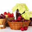 图库照片: Different grades of sweet cherry in buckets, basket with sweet cherry and jars of jam