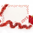 Red card on New Year 2013 with colorful tinsel and red balls isolated on white — Stock Photo #32297881