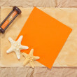 Old paper, two starfishes, hourglasses and orange card — Stock Photo #32298035