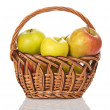 Wattled basket with the apples, isolated on white — Photo