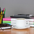 Folders for documents a office supply in a support hourglasses and a cup of coffee on a table — Stock Photo #32298161