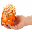 Man's hand holding the gift box, isolated on white — Stock Photo