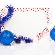 Happy New Year 2013 greeting card and blue tinsel, colorful balls isolated on white — Stock Photo #32298381