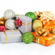 Christmas decorations and gift boxes isolated on white — Stock Photo