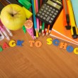 Exercise books, a big set of school tools the calculator and apple on a table — Stock Photo