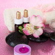 Candle, flower, stones with water drops, on the pink — Stock Photo