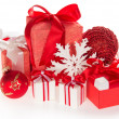 Big and small gift boxes, the Christmas toys, snowflakes — Stock Photo