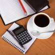 Open notepad, organizer, empty sheets for notes a pencil, the handle, the calculator, cup of coffee on a table — Stock Photo #32299395