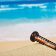 Hourglasses on a sandy beach — Stock Photo
