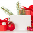Christmas toys and gifts, fir-tree branch and empty card isolated on white — Foto Stock