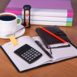Notepad, organizer, folders for documents the calculator, hourglasses and a cup of coffee on a table — Stok Fotoğraf #32299977