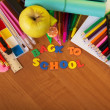 Inscription from the plastic letters ''Back to school'' and a set of school tools — Stock Photo