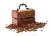 Brown wooden chest, coffee grains isolated on white — Stock Photo