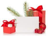 Fir-tree branch, Christmas toy, gift boxes and the empty card isolated on white — Stock Photo