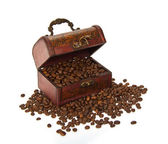 Chest with the coffee grains, isolated on white — Stock Photo