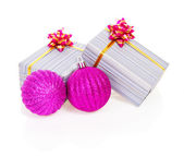 Pink christmas balls and gift boxes in striped paper isolated on white — Stock Photo