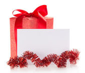 Bright gift box, tinsel and the empty card, isolated on white — Stock Photo
