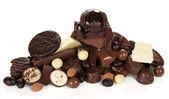 Various chocolates, sweet food, isolated on white — Stock Photo