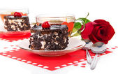 Romantic tea drinking in Valentine's day with chocolate cakes and red rose isolated on white — Stockfoto