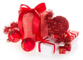 Red, and white gift box, spheres, small souvenirs and tinsel — Stock Photo