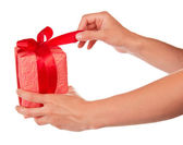 The female hand ties a bow on the gift box — Stock Photo