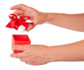The female hand opens a box with a gift, isolated on white — Stock Photo