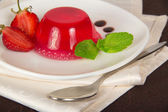 Plate with jelly and a spoon on a napkin, closeup — Stock Photo