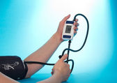The person supervising a blood pressure by a tonometer — Stock Photo