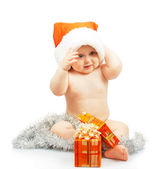 Positivity naked child in Santa Claus red hat with silver tinsel, colorful christmas festive gift isolated on white — Stock Photo
