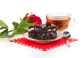 Chocolate cherry cake, hot tea and red rose isolated on white — Stock Photo