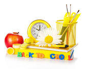 Support with school accessories, watches, a set of plastic letters, flower and the apple, isolated on white — Stock Photo