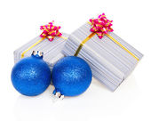 Blue christmas balls and festive gifts isolated on white — Stock Photo