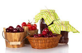 Sweet cherry in buckets, and jars of jam — Stock Photo