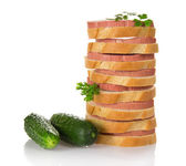 Sandwiches with the sausage, parsley and two green cucumbers — Stock Photo