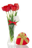 Tulips in a vase and a gift with the golden bow, isolated on white — Stock Photo