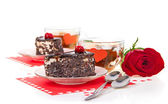Romantic tea drinking with chocolate cakes and red rose isolated on white — Stock Photo
