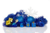Blue christmas balls and blue, gold gift boxes, blue tinsel, snowflakes isolated on white — Stock Photo
