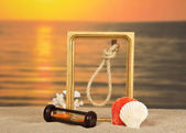 Frame, set of sea cockleshells, hourglasses against a decline — Stock Photo