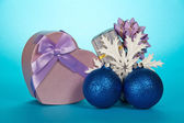 Two gift boxes, Christmas toys and snowflake on a blue background — Stock Photo
